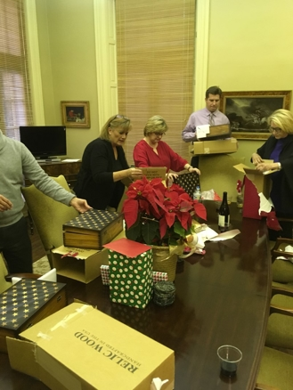 Kinnard Clayton & Beveridge employees open their presents.